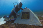 A diver with a commemorative marker on the Sirius site. Photo: Western Australian Museum